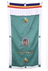 Tibetischer Türbehang, verschiedene Symbole, grün